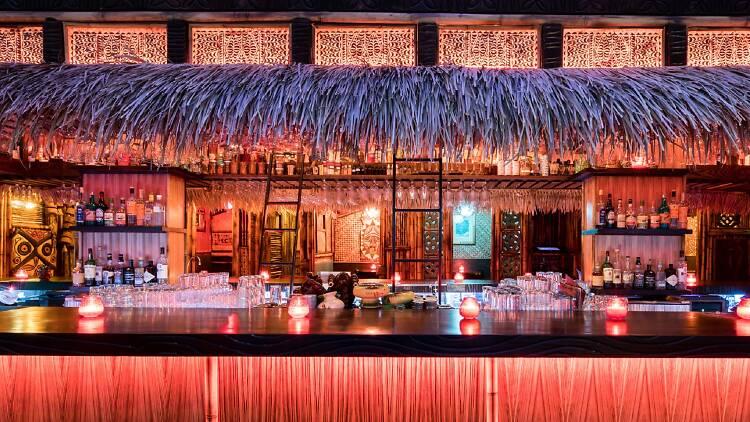 The bright tiki bar at Zombie Village