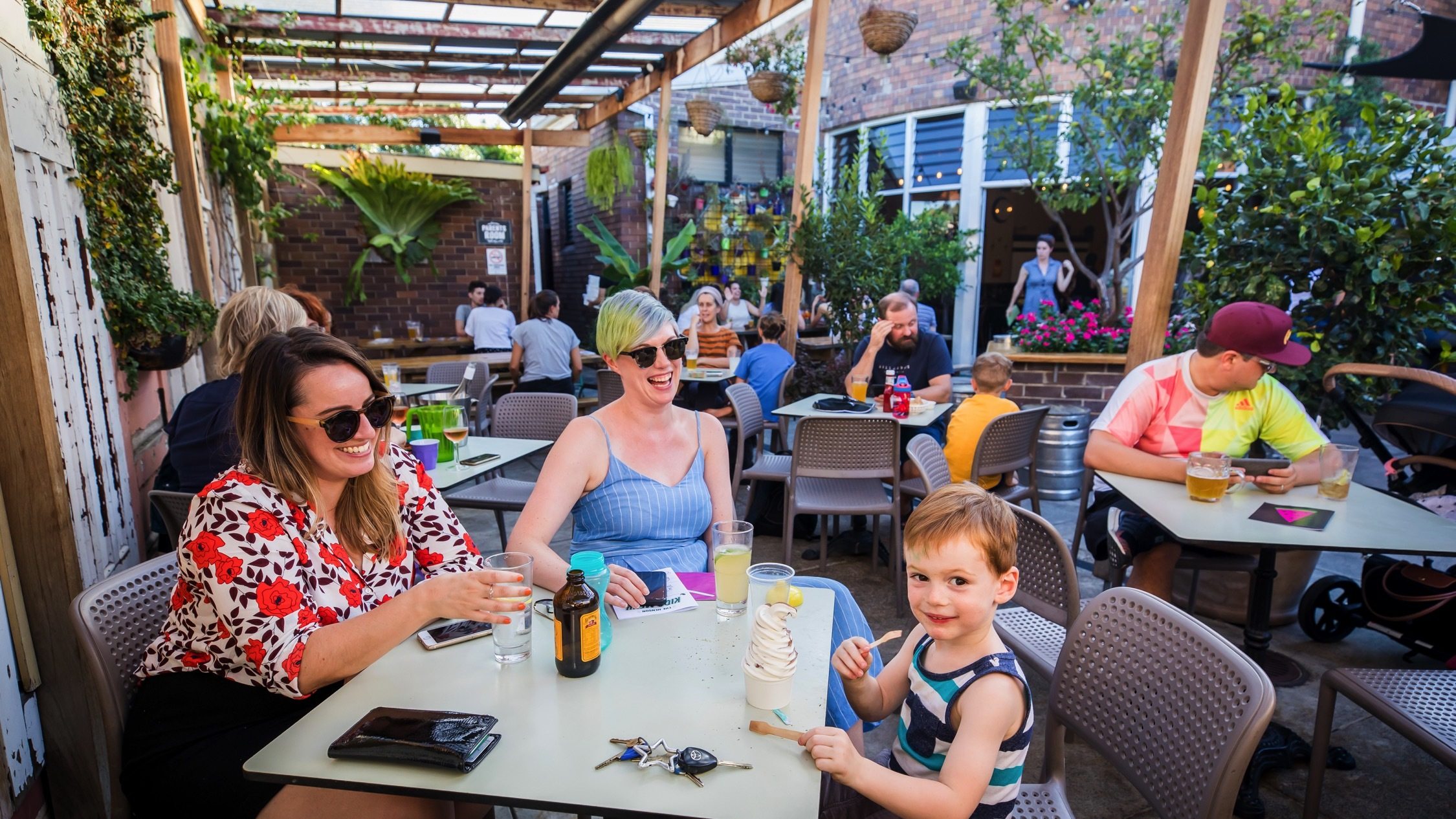 Family sitting in courtyard at The Henson Marrickville