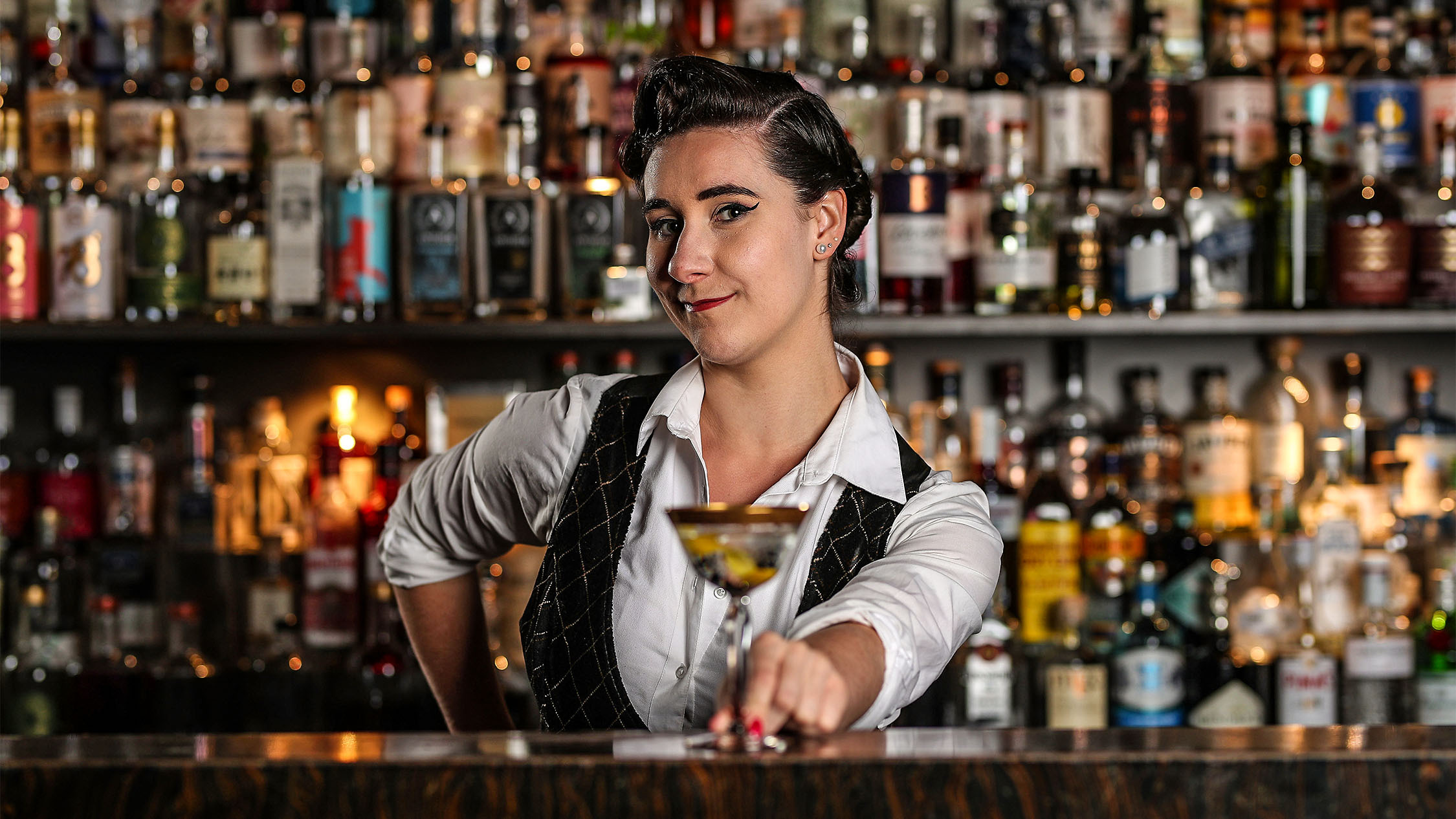 Portrait shot of Jessica Clayfield, Gin Palace behind the bar