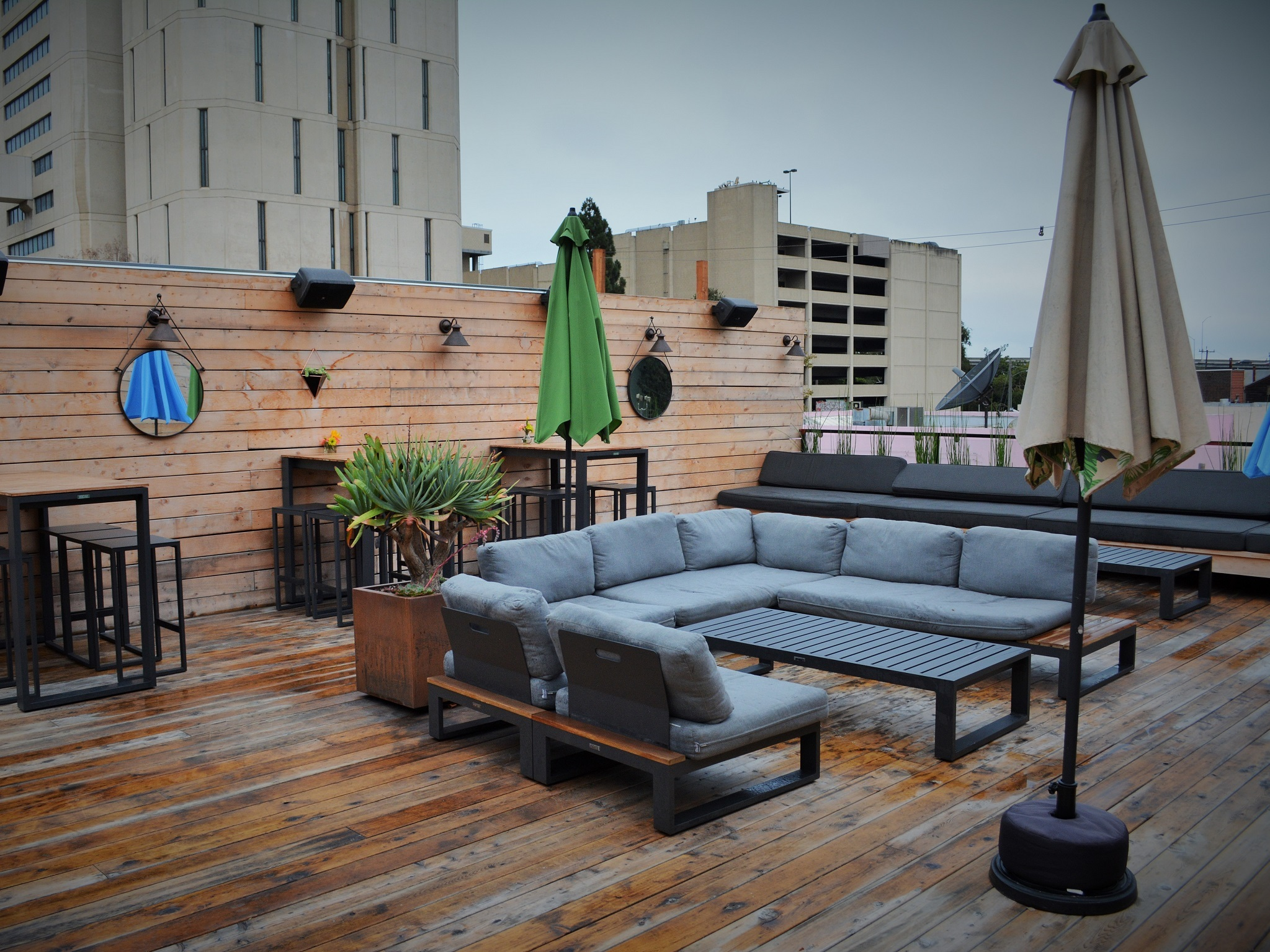 Blue couches and umbrellas on a roof deck
