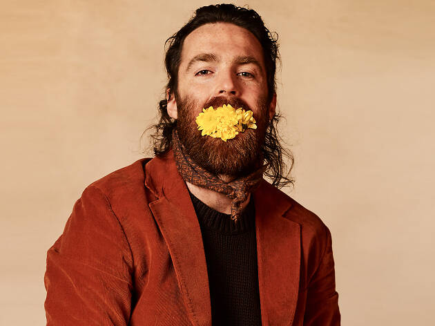 Nick Murphy with yellow flowers in his mouth (weird).