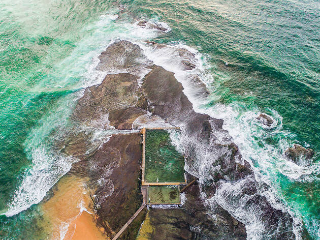 Drone shot from above looking down at Mona Vale ocean pool