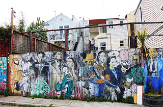A mural of people in front of houses