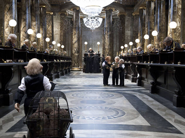 Ron and Hermione in disguise enter Gringott's Bank and ask to see the vault; They get worried (SC191).