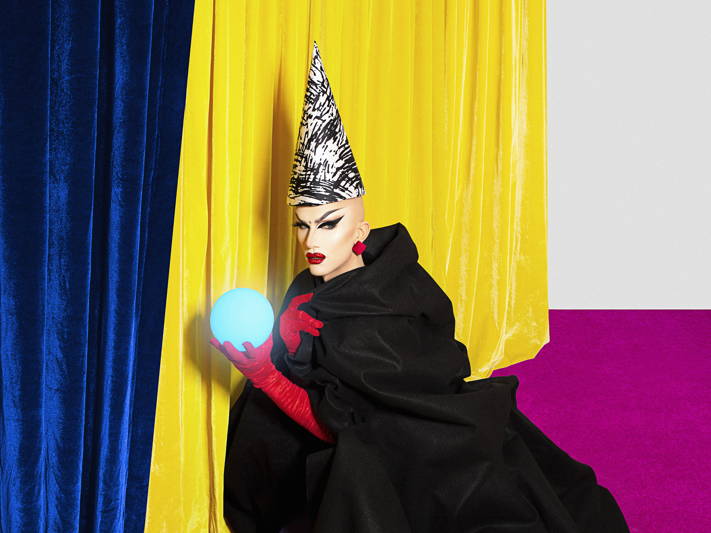 Sasha Velour holds a crystal ball in Smoke & Mirrors