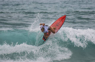 Person surfing at the Vissla Sydney Surf Pro.