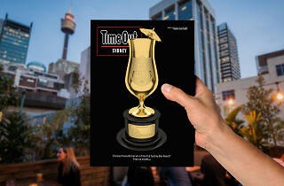 Hand holding magzine Time Out Sydney #156