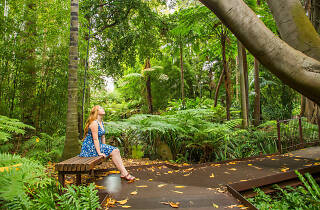 Woman on bench at Royal Botanic Gardens Victoria
