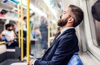 Man sleeping on London tube train
