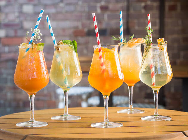 Five Spritz cocktails on a table