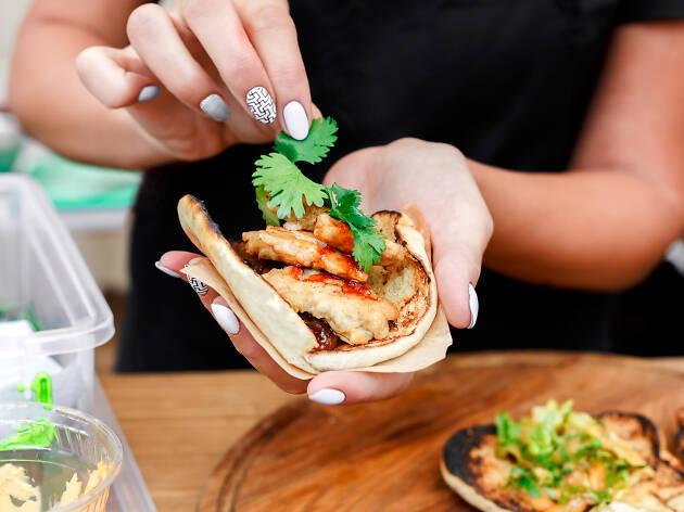 Woman garnishing a taco