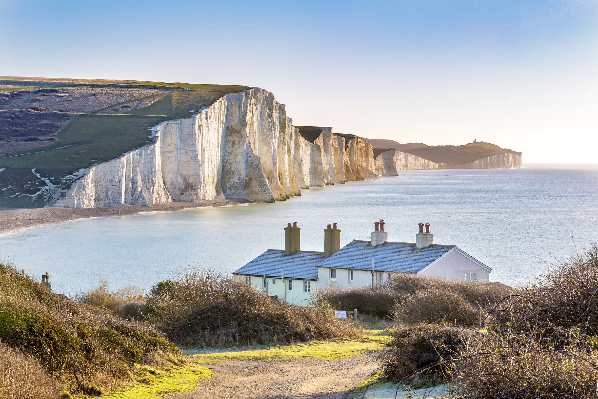 The Coast Guard Cottages & Seven Sisters Chalk Cliffs just outside Eastbourne, Sussex, England, UK