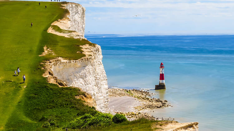 White chalk cliffs and aerial view of the Beachy Head Lighthouse, Eastbourne, East Sussex, England