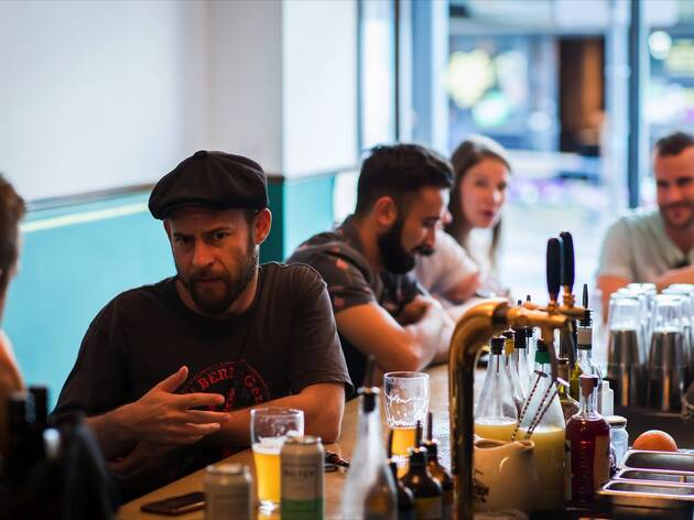 People sitting at bar at Golden Gully