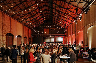 People at an evening talk inside Carriageworks at the Sydney Writers' Festival