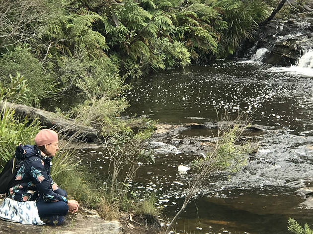Person looking out at a river.