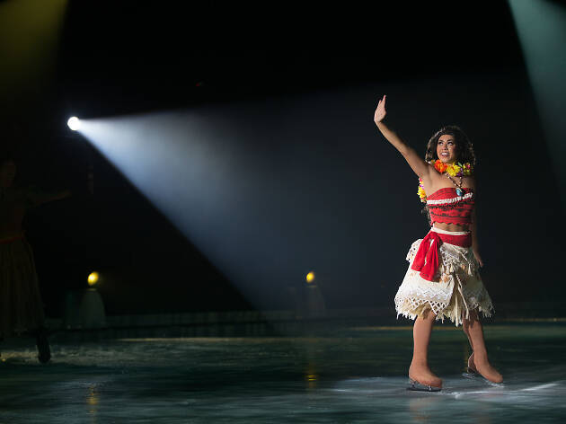 Actor dressed as Moana skating on ice.