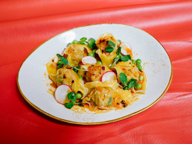"<meta charset=""utf-8"" /><p><span>Wontons in chili oil</span></p>"