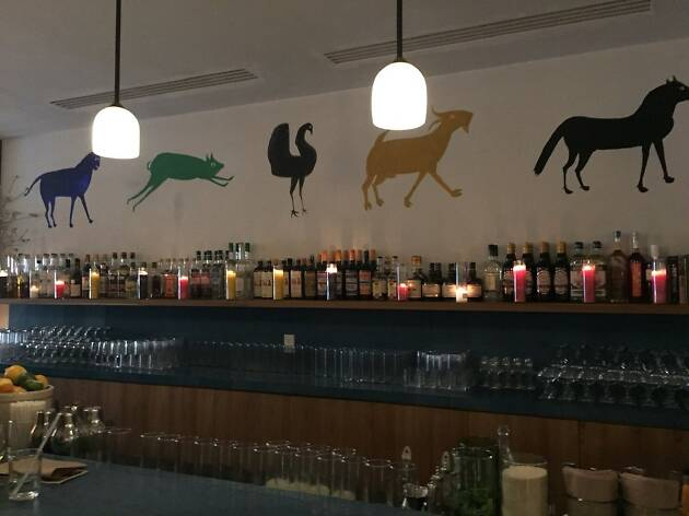 A simple bar with different colored animal paintings above