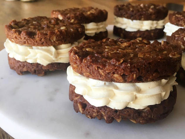 Two Anzac biscuits with a cream filling