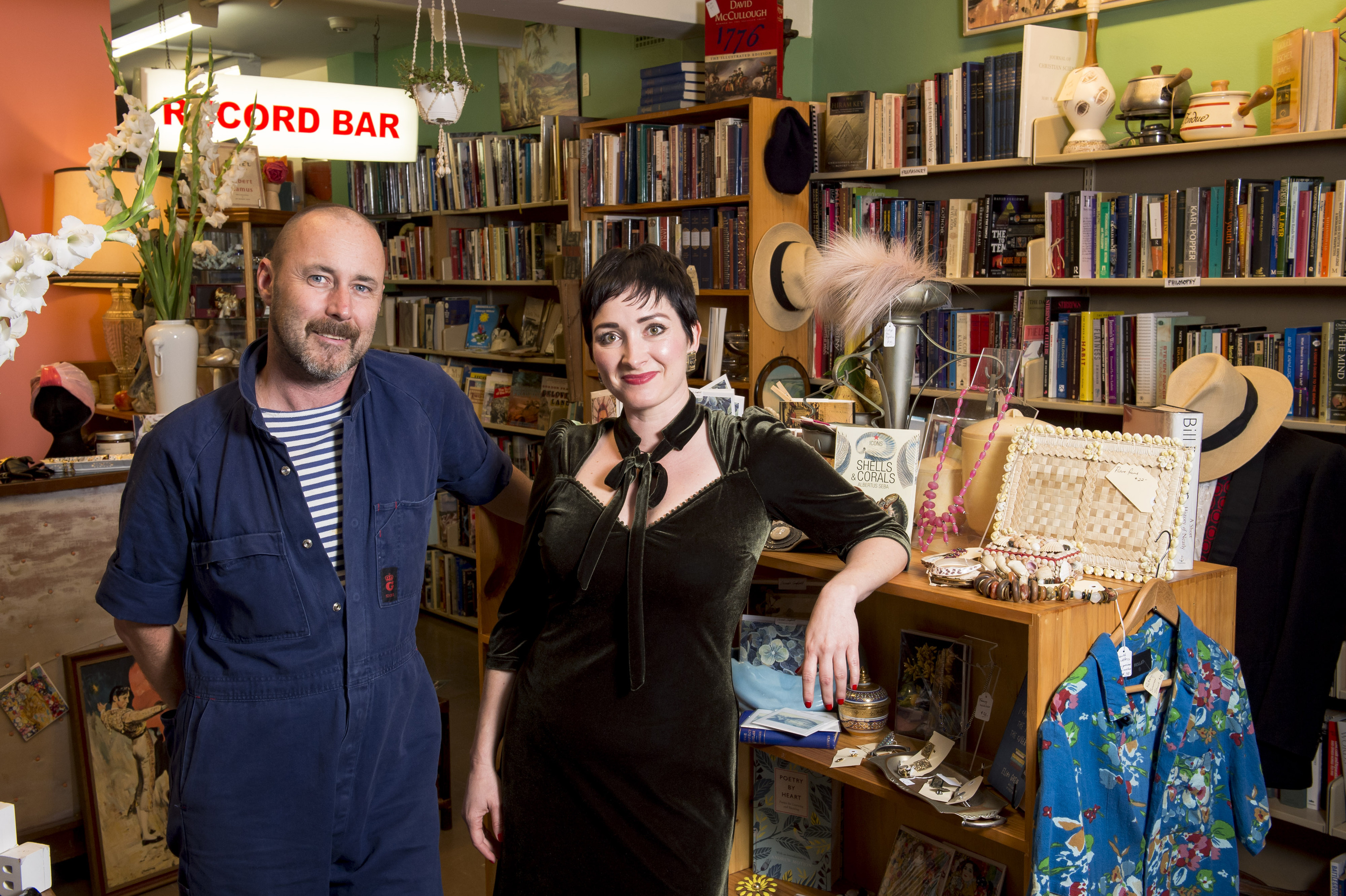 Tom Hespe (left) and Tamara Kennedy (right) standing in their Potts Point book, vintage and record store in Potts Point