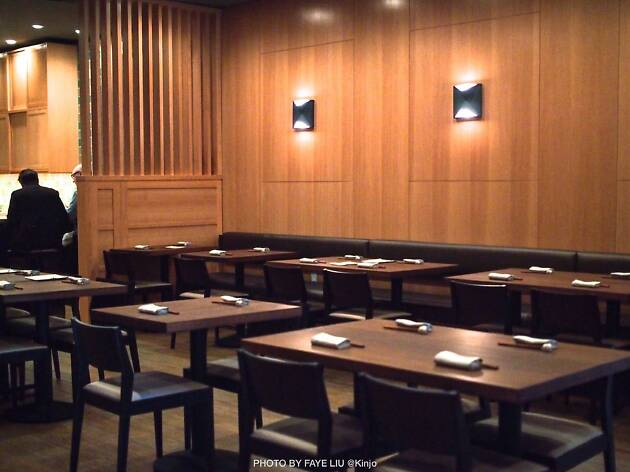 The bamboo paneled walls and tables of Kinjo