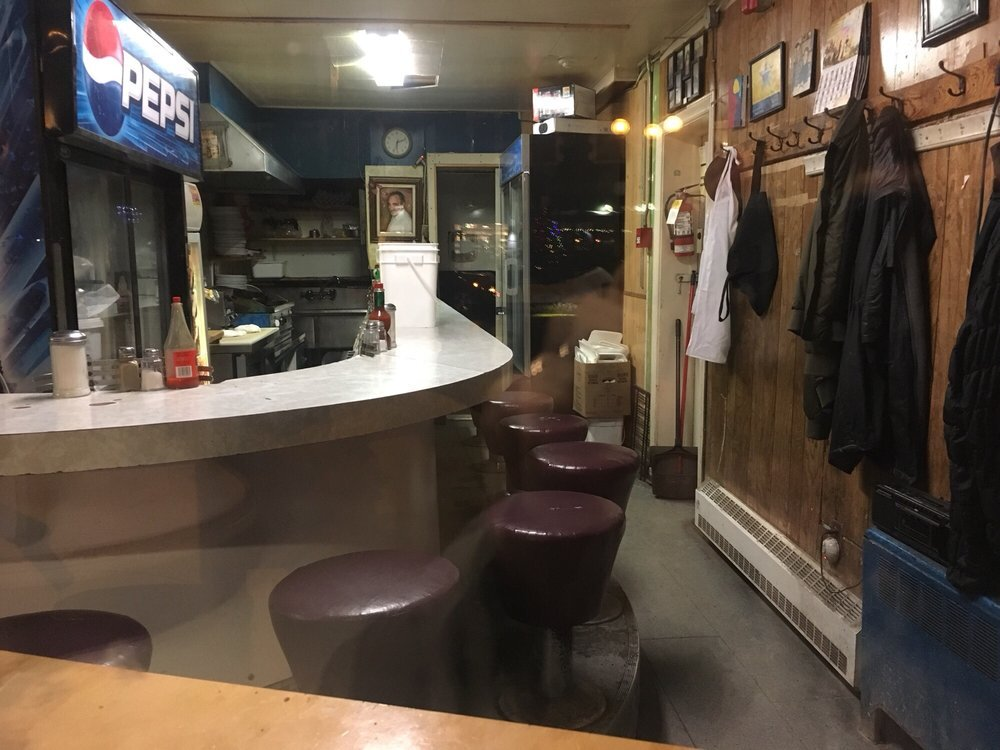 NDG's legendary greasy spoon Cosmos Snack Bar is for sale