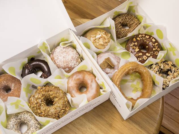 Boxes of iced doughnuts.