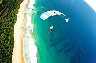 Person skydiving over the beach in Wollongong