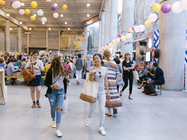 People walking in a market at Finders Keepers.