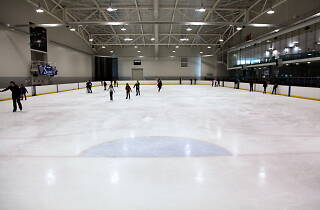 People skating on the ice at the LCC Ice Rink.