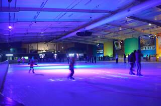 People ice skating at a disco night at Penrith Ice Palace.