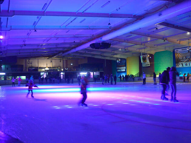 People ice skating at a disco night at Penrith Ice Palace.