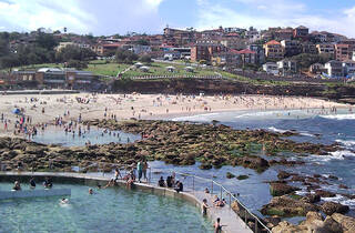 Crowd on the sand and in the water at Bronte Beach