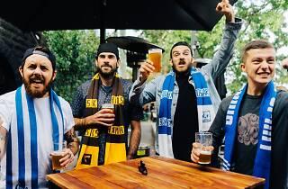 Footy fans in scarves at Riverland Bar
