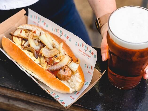 A sausage and pint at Riverland Bar