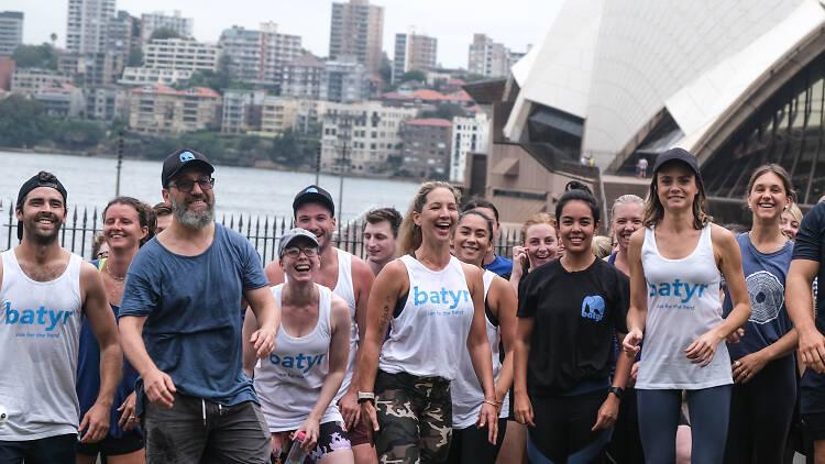 group of runners, fun run, opera house
