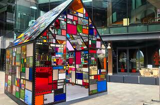 Artist Tom Fruin has installed a multicolored glass house outside Time Out Market