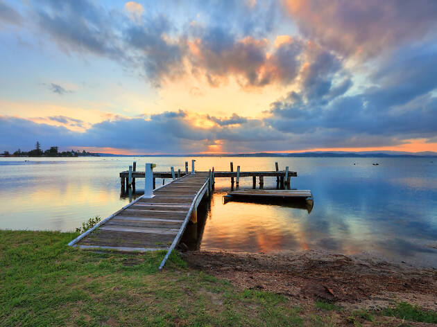Sunset at Belmont, Lake Macquarie over a jetty.