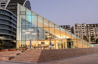 The glass pyramid at the Green Square Library at sunset