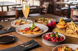 A table set with brunch dishes and a mimosa
