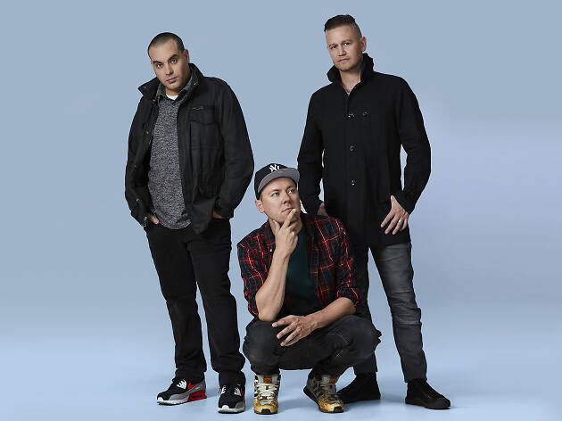 The artists from the Hilltop Hoods pose in jackets.