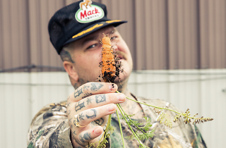 The celebrity chef holding up a freshly unearthed carrot
