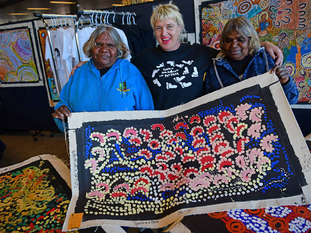 Indigenous women showing artworks at the National Indigenous Art Fair.