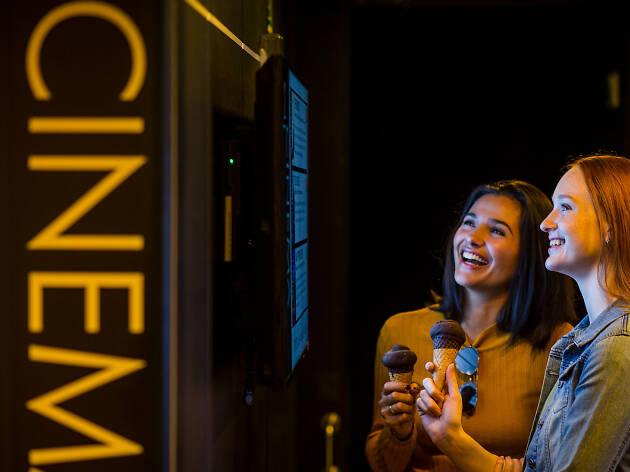 Travellers visiting the cinema on the Spirit of Tasmania