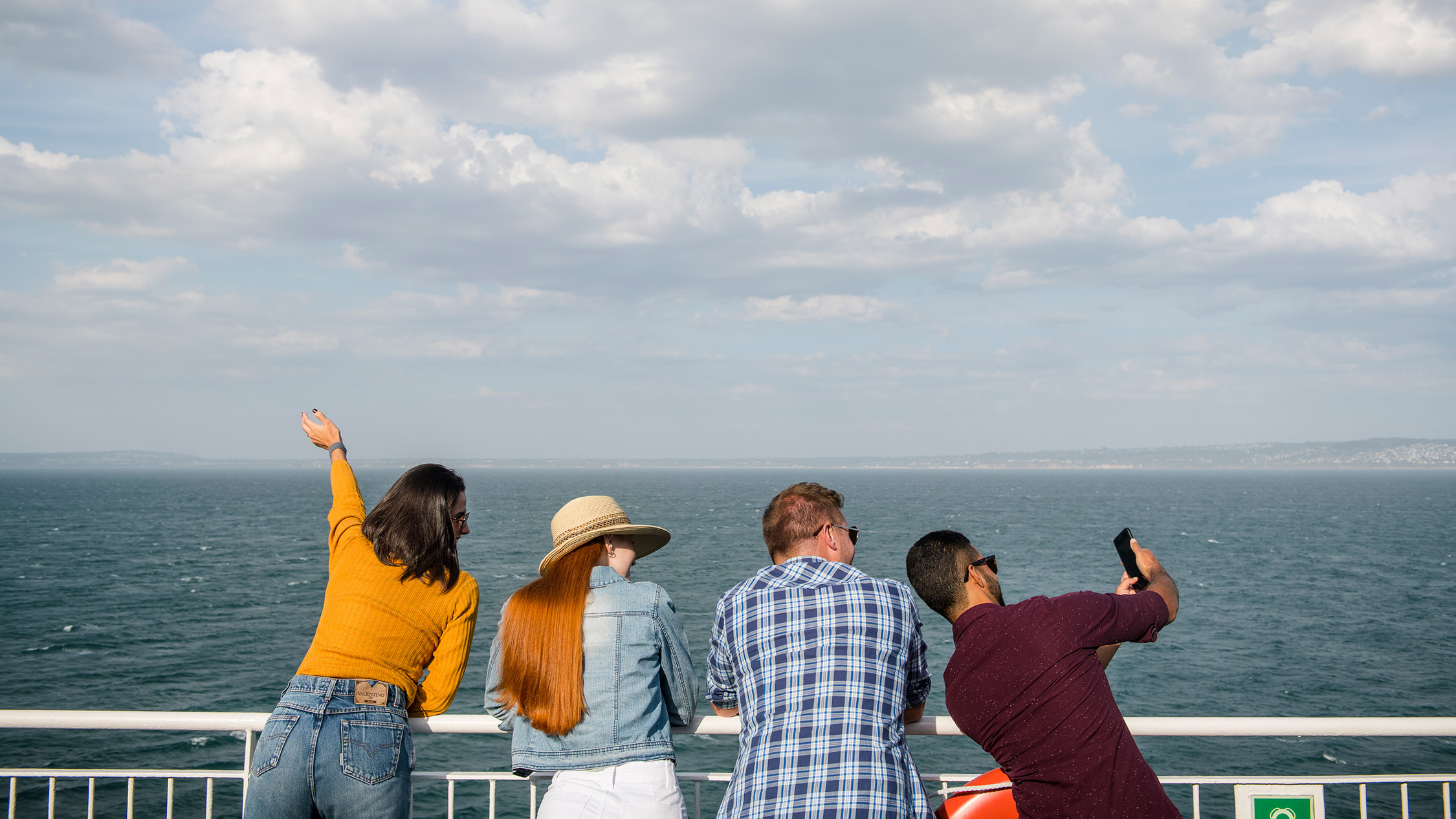 Four travellers looking out to the Bay on the Spirit of Tasmania