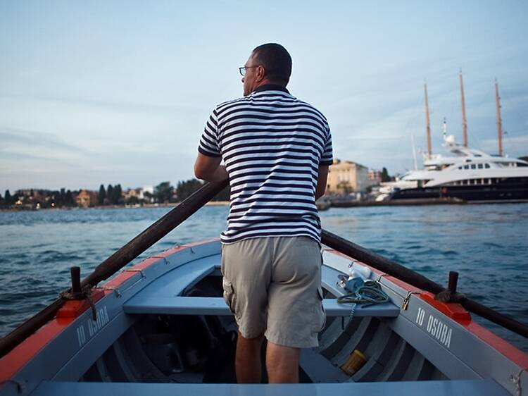 Over the water by rowboat