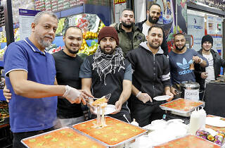 Men working at the Ramadan Nights Lakemba markets