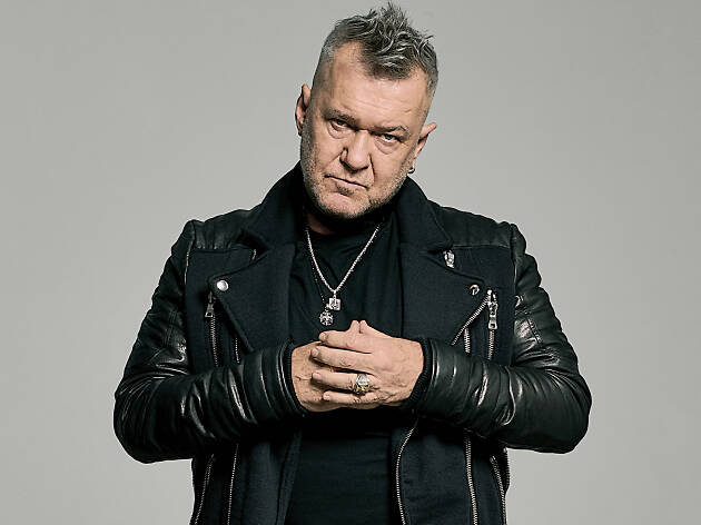 Jimmy Barnes looking angry in a sassy black outfit.