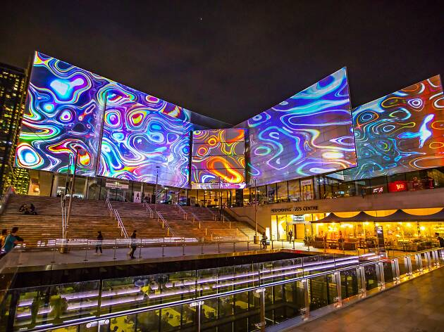 The Vivid Light installations at Chatswood showing huge glowing billboards.